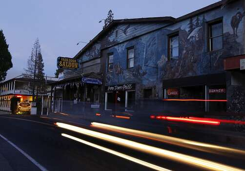 The historic Iron Door Saloon remains open for business in Groveland, Calif. despite the Rim Fire raging out of control on Friday, Aug. 23, 2013. The wild fire has scorched over 150 square miles of terrain. Photo: Paul Chinn, The Chronicle