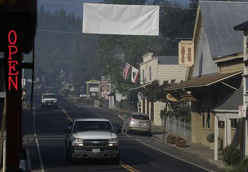 Despite evacuation orders and a sudden drop in tourism because of the Rim Fire, many residents chose to stay in town and keep their businesses open in Groveland, Calif. on Saturday, Aug. 24, 2013. Photo: Paul Chinn, The Chronicle