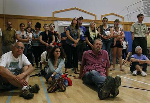 Residents gather in the gymnasium of the local school to hear updates on the Rim Fire in Groveland, Calif. on Friday, Aug. 23, 2013. The wild fire has scorched over 150 square miles of terrain. Photo: Paul Chinn, The Chronicle