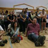 Residents gather in the gymnasium of the local school to hear updates on the Rim Fire in Groveland, Calif. on Friday, Aug. 23, 2013. The wild fire has scorched over 150 square miles of terrain.