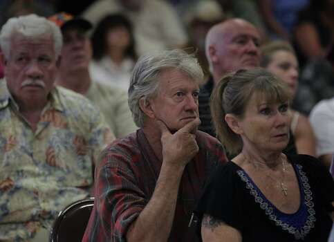 Paul Frank (center), who owns a home in nearby Greely Hill, attends a community meeting to hear updates by fire officials on the Rim Fire in Groveland, Calif. on Friday, Aug. 23, 2013. Photo: Paul Chinn, The Chronicle