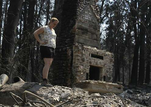 Corinna Loh gets her first look at the remains of a 4-bedroom home at her family's Spinning Wheel Ranch resort in Tuolumne County on Saturday, Aug. 24, 2013. The Rim Fire blazed through the property earlier in the week, destroying the home Loh grew up in, which was among several vacation rental homes on the property, as well as a 2-bedroom cabin. Photo: Paul Chinn, The Chronicle