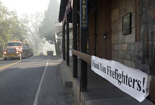 Residents display their appreciation for emergency responders with a banner in front of the Iron Door Saloon in Groveland, Calif. on Saturday, Aug. 24, 2013. The Rim Fire has scorched over 150 square miles of terrain. Photo: Paul Chinn, The Chronicle