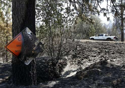 A burned road sign is a reminder of the Rim Fire still burning out of control in Tuolumne County on Saturday, Aug. 24, 2013. Photo: Paul Chinn, The Chronicle