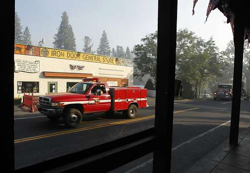 Fire personnel drive on Highway 120 in Groveland, Calif. on Saturday, Aug. 24, 2013. The Rim Fire has scorched over 150 square miles of terrain. Photo: Paul Chinn, The Chronicle