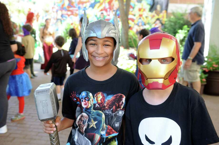 Jayden Paltoo, 9, of Bridgeport, left, and Kyle Miller, 9, of Shelton, attend ComiCONN at the Marriot Hotel in Trumbull, Conn. Saturday, Aug. 24, 2013. Photo: Autumn Driscoll / Connecticut Post