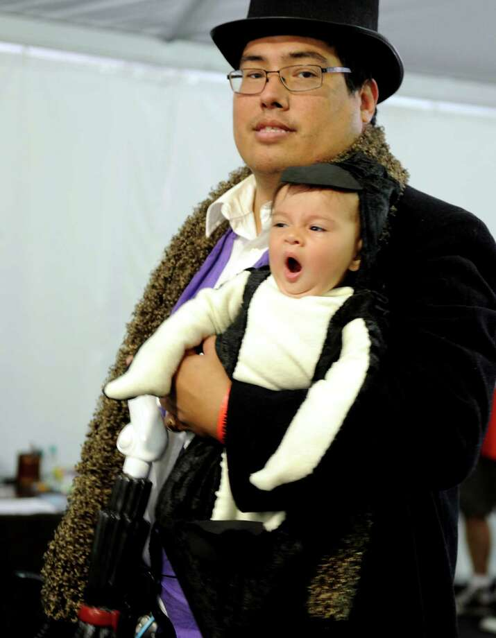 Harry Elrod, of Baltic, and his seven-month-old daughter Teresa both dressed like the Penguin, a DC Comics supervillain, at the Marriot Hotel in Trumbull, Conn. Saturday, Aug. 24, 2013 during ComiCONN, the comic book and sci-fi themed collectibles show. Photo: Autumn Driscoll / Connecticut Post