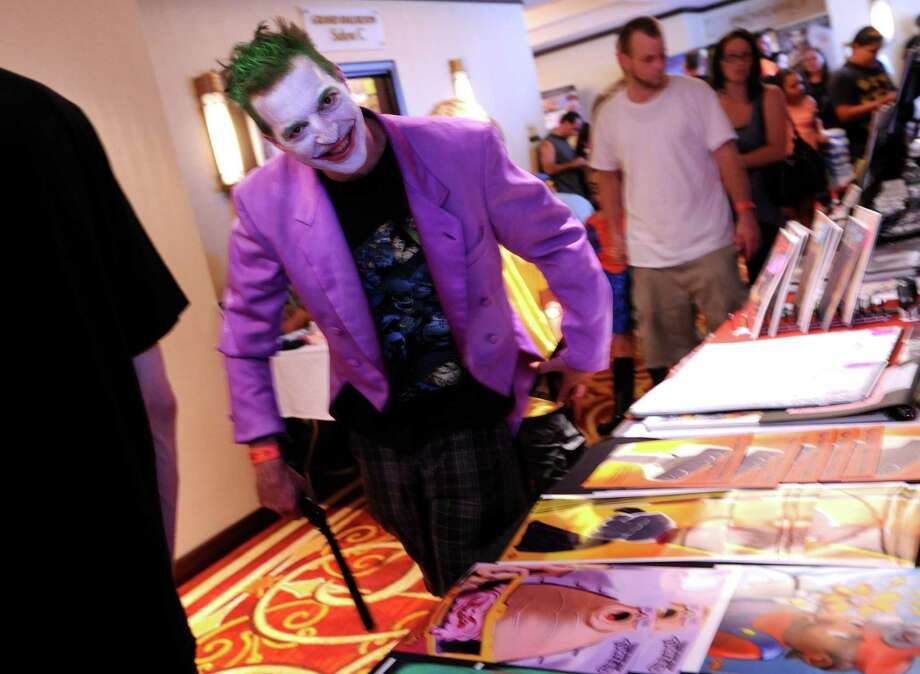 Joker Rich Feldstein, of Milford, walks through the Marriot Hotel in Trumbull, Conn. Saturday, Aug. 24, 2013 during ComiCONN, the comic book and sci-fi themed collectibles show. Photo: Autumn Driscoll / Connecticut Post
