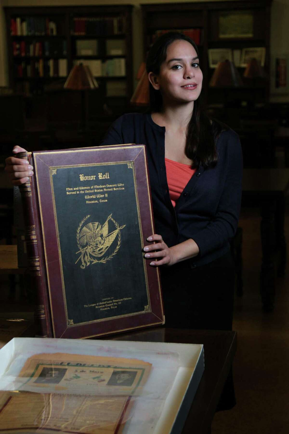 Mikaela Garza Selley, a Houston Public Library archivist whose duty is to oversee Hispanic materials, was excited to discover a leather-bound honor roll of Hispanic World War II veterans in the archives.