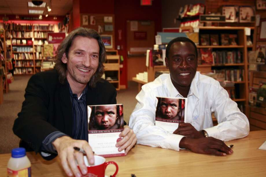 "WASHINGTON - MAY 2:  Actor Don Cheadle (R) attends a book signing with co-author John Prendergast for their new book, ""Not On Our Watch"" at Borders on May 2, 2007 in Washington, DC. (Photo by Nancy Ostertag/Getty Images) Photo: Nancy Ostertag, Getty Images"