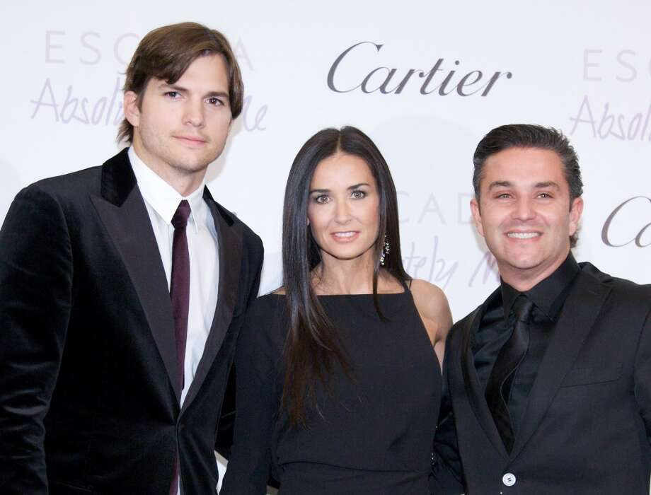 MOSCOW, RUSSIA - OCTOBER 30: (L-R) Ashton Kutcher, Demi Moore and general director Cartier Russia & CEI Francois Marc Sastre attend the red carpet for the Demi & Ashton Foundation and the Russian Assemblies Charity Gala at the Ritz-Carlton hotel on October 30, 2010 in Moscow, Russia. Demi Moore and Ashton Kutcher were accessorized by Cartier, one of the sponsors of the charity gala. (Photo by Oxana Sazonova/Getty Images) Photo: Oxana Sazonova/GC, Getty Images