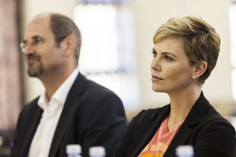DURBAN, SOUTH AFRICA - AUGUST 2:  HIV/AIDS campaigner and actress Charlize Theron visits a Youth Ambassador Project funded by the Global Fund to Fight AIDS, Tuberculosis & Malaria at the Malangeni Thusong Centre, on August 2, 2013 in the Ugu district of KwaZulu Natal, South Africa. Charlize Theron spoke with beneficiaries of the Youth Ambassador Program, joined group discussions and refereed a soccer match between ambassadors and beneficiaries of the project to help prevent the spread of HIV. The program, supported by the Global Fund to Fight AIDS, Tuberculosis and Malaria, trains young men and women in KwaZulu Natal province to disseminate HIV prevention messages by engaging with youth in schools, support groups, churches, at sport events and in their homes. (Photo by Justin Barlow/Getty Images for The Global Fund) Photo: Getty Images
