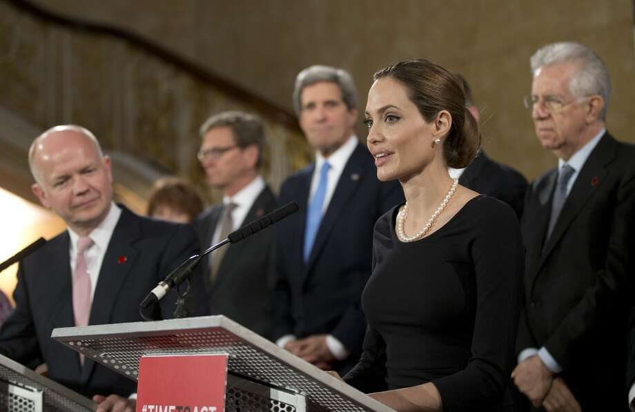 LONDON, ENGLAND - APRIL 11:  Actress Angelina Jolie (R) in her role as UN envoy, talks during  a news conference regarding sexual violence against women in conflict, as British Foreign Secretary William Hague and other G8 Ministers look on at the Foreign Ministers G8 meeting in Lancaster House on April 11, 2013 in London, England. G8 Foreign Ministers are holding a two day meeting where they will discuss the situation in the Middle East, including Syria and Iran, security and stability across North and West Africa, Democratic People's Republic of Korea and climate change. British Foreign Secretary William Hague will also highlight five key policy priorities.  (Photo by Alistair Grant  - WPA Pool/Getty Images) Photo: WPA Pool, Getty Images