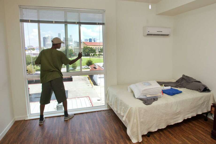 Midtown's Travis Street Plaza, a new affordable housing development, represents a fresh start for veterans like Clarence Brown, who served in the Air Force and moved on Friday into one of 192 units at the facility, which was developed by Cloudbreak Communities. Photo: Brett Coomer, Staff / © 2013 Houston Chronicle