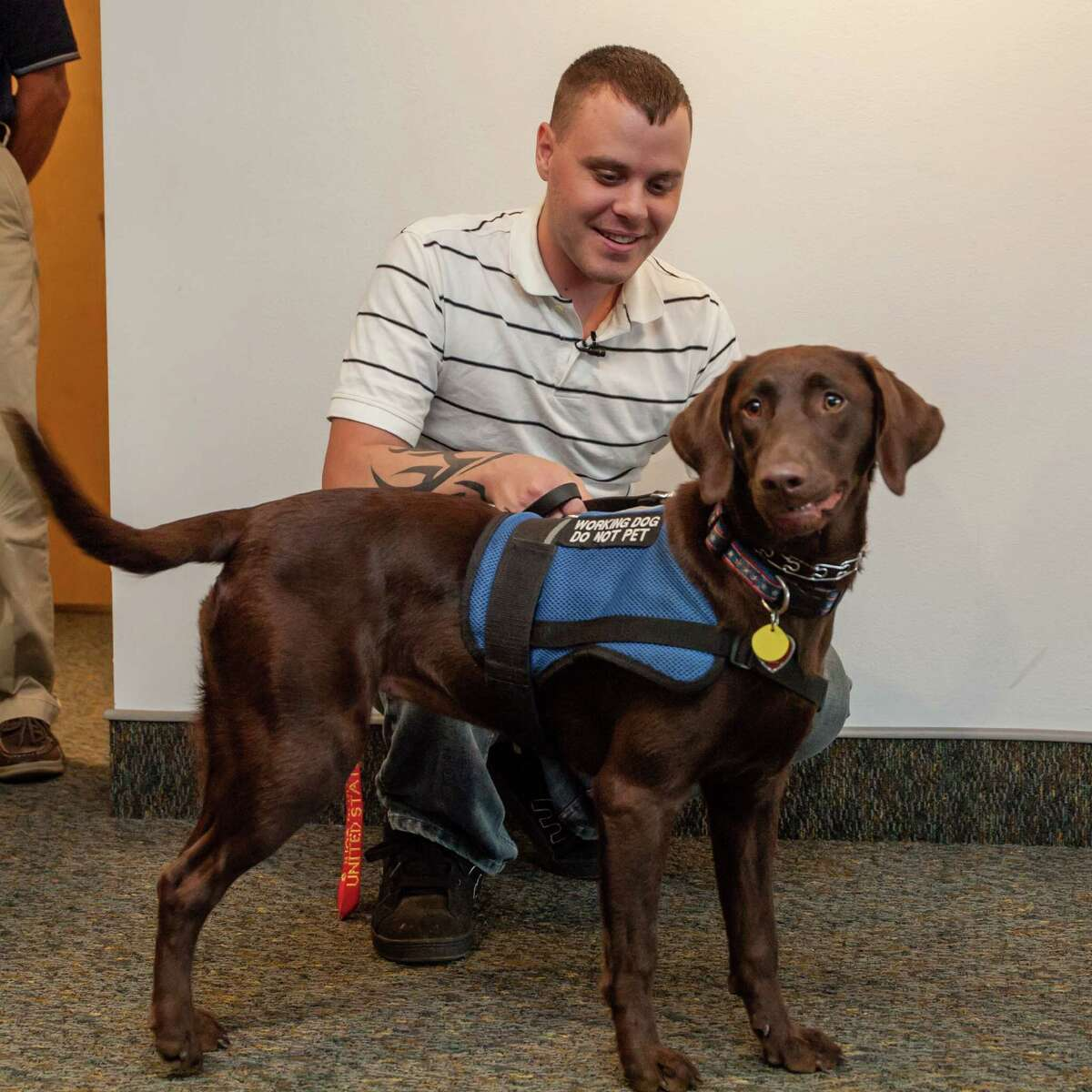 Ottmar Klass / STRIDE Adaptive Sports Jeremony Walton of Castleton, a disabled Marine veteran, greets his new service dog, Alanna, after the canine arrived at the Albany International Airport in Colonie on Aug. 17.