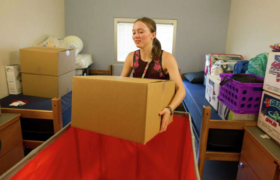 U of H freshmen Haley Thomas unpacks during move in day at Cougar Village II on Thursday, Aug. 22, 2013, in Houston. Photo: J. Patric Schneider, For The Chronicle / © 2013 Houston Chronicle