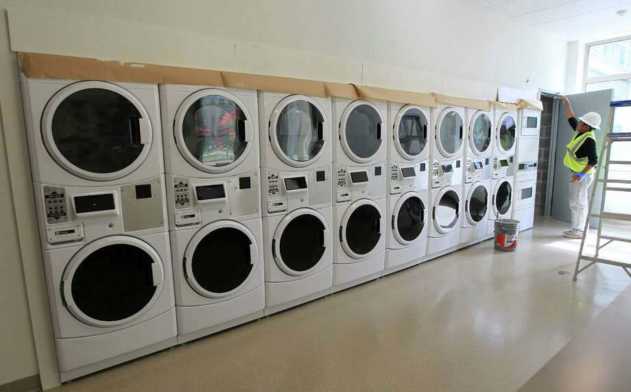 A laundry room in Cougar Place during a tour of the new dorms, Cougar Place and Cougar Village II.,  on the University of Houston campus, Wednesday, Aug. 14, 2013, in Houston. Photo: Karen Warren, Houston Chronicle / © 2013 Houston Chronicle