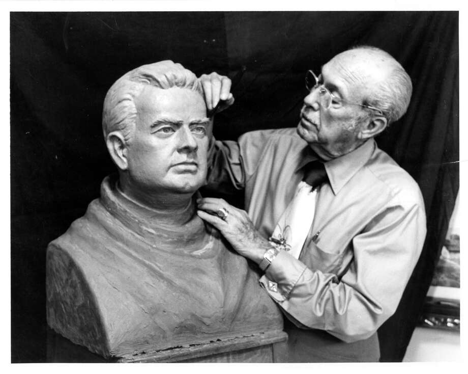 Mr. Louis Rodriguez works on a bust clay sculpture of Father Moczygemba. Photo: Copy Photo By Joe Holley, Houston Chronicle / Houston Chronicle