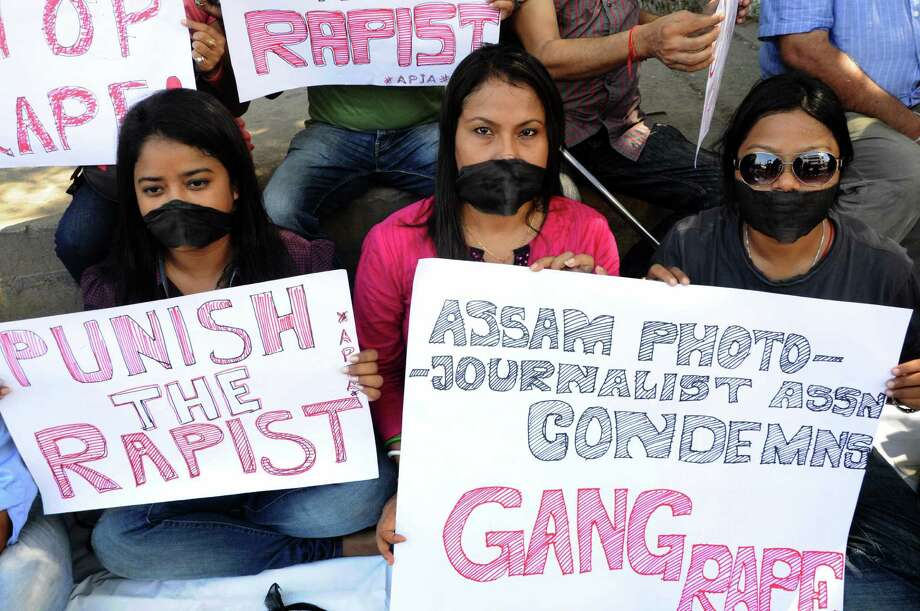 Indian photojournalists and journalists stage a demonstration to express their thoughts about the gang-rape of a female colleague in Mumbai. The attack, which happened Thursday, has renewed anger over the country's treatment of women. Photo: Biju Boro / Getty Images