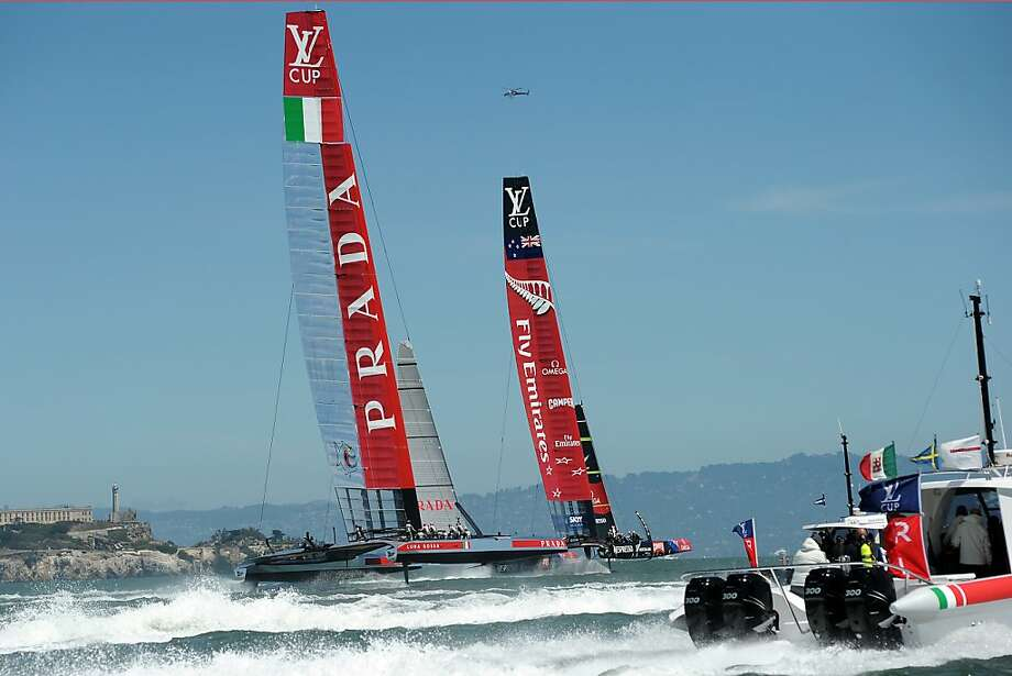 Team New Zealand (right) - which hit 54 mph in the race - speeds away from Luna Rossa Challenge en route to its sixth victory in seven tries in the best-of-13 Louis Vuitton Cup finals. Photo: Michael Short, Special To The Chronicle