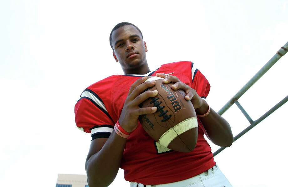 Lamar's Darrell Colbert has heard the same thing throughout his football career - that at 5-11 he's too short to play quarterback. Photo: Karen Warren, Staff / © 2013 Houston Chronicle