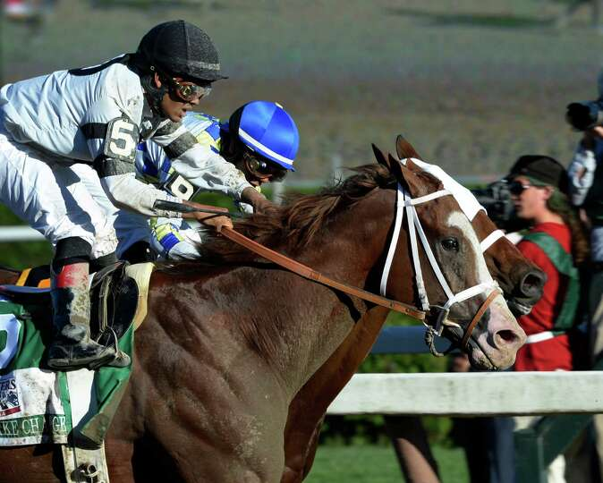 Will Take Charge with jockey Luis Saez, foreground catches Moreno with jockey Jose Ortiz, center to