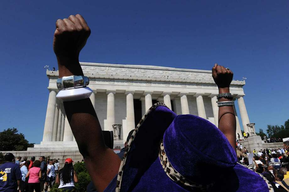 "People react to speakers during the 50th anniversary of the March on Washington and Dr. Martin Luther King Jr.'s ""I have a Dream"" speech at the Lincoln Memorial in Washington, D.C., Saturday, August 24, 2013. Photo: Olivier Douliery, McClatchy-Tribune News Service / Abaca Press"