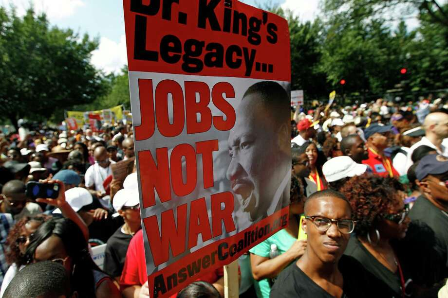 "Participants march down Independence Avenue away from the Lincoln Memorial during the rally to commemorate the 50th anniversary of the 1963 March on Washington Saturday, Aug. 24, 2013, in Washington. Tens of thousands of people marched to the Martin Luther King Jr. Memorial and down the National Mall on Saturday, to commemorate King's famous """"I Have a Dream"" speech, made Aug. 28, 1963, during the March on Washington, and pledging that his dream includes equality for gays, Latinos, the poor and the disabled. Photo: Jose Luis Magana, Associated Press / FR159526 AP"