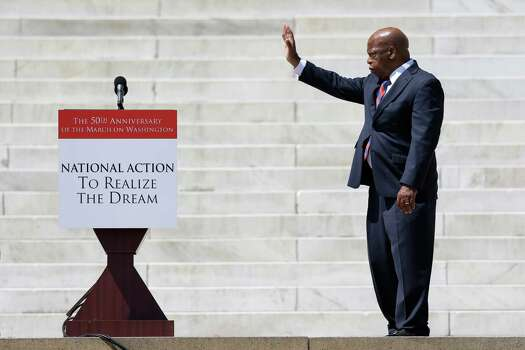 Rep. John Lewis, D-Ga., waves to the King family and Rev. Al Sharpton after speaking during an event to commemorate the 50th anniversary of the 1963 March on Washington at the Lincoln Memorial, Saturday, Aug. 24, 2013, in Washington. Photo: Carolyn Kaster, Associated Press / AP