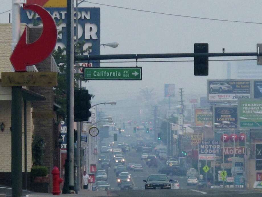 A smoky haze blankets downtown Reno, Nev., on Friday afternoon as massive wildfires burned 150 miles to the south at Yosemite National Park. Photo: Scott Sonner / Associated Press