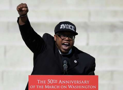 "Rev. Lennox Yearwood Jr., president and CEO of the Hip Hop Caucus, speaks during an event to commemorate the 50th anniversary of the 1963 March on Washington at the Lincoln Memorial, Saturday, Aug. 24, 2013, in Washington. Tens of thousands of people marched to the Martin Luther King Jr. Memorial and down the National Mall on Saturday, to commemorate King's famous """"I Have a Dream"" speech, made Aug. 28, 1963, during the March on Washington, and pledging that his dream includes equality for gays, Latinos, the poor and the disabled. Photo: Carolyn Kaster, Associated Press / AP"