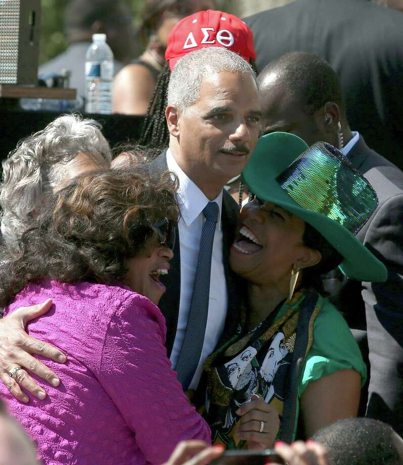 Attornery General Eric Holder gets a hug from Rep. Frederica Wilson (D-FL) (R) during the 50th anniversary of the March on Washington and Dr. Martin Luther King, Jr.'s 'I have a Dream' speech at the Lincoln Memorial on August 24, 2013 in Washington, DC. The event included a commemorative march and rally along the historic route followed on August 28, 1963 and is being led by civil rights leader Al Sharpton and Martin Luther King III, King's oldest son. Photo: Mark Wilson, Getty Images / 2013 Getty Images