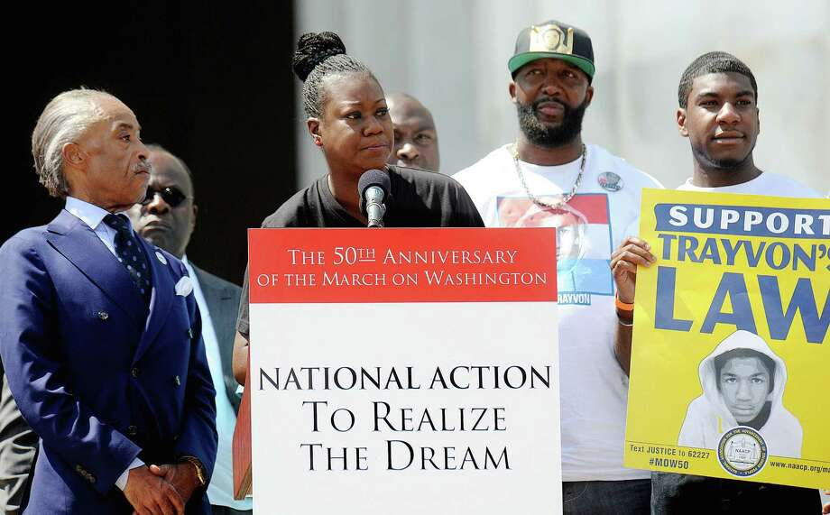 "Sybrina Fulton and Tracy Martin, the parents of Trayvon Martin, attend the 50th anniversary of the March on Washington and Dr. Martin Luther King, Jr.'s ""I have a Dream"" speech in Washington, D.C., Saturday, August 24, 2013. Photo: Olivier Douliery, McClatchy-Tribune News Service / Abaca Press"
