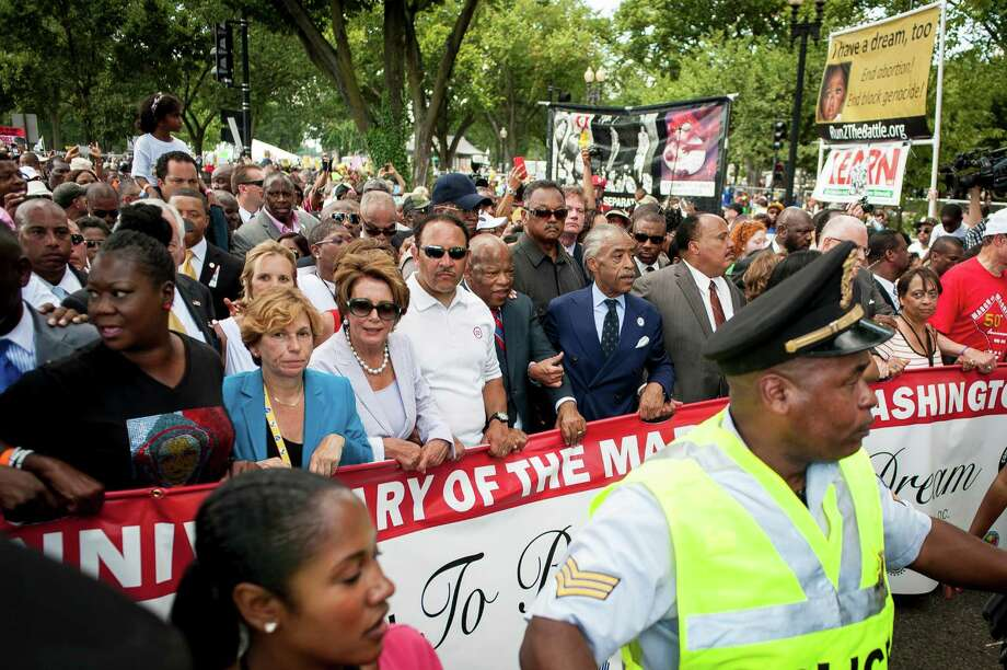 Rep. John Lewis (D-GA), Rev. Al Sharpton and Martin Luther King III join other politicians and activists to celebrate the 50th anniversary of the March on Washington and Dr. Martin Luther King, Jr.'s 'I have a Dream' speech on the National Mall on August 24, 2013 in Washington, DC. A commemorative march and a rally along the historic route followed in 1963 is led by civil rights leaders Al Sharpton and Martin Luther King III. Photo: Pete Marovich, Getty Images / 2013 Getty Images