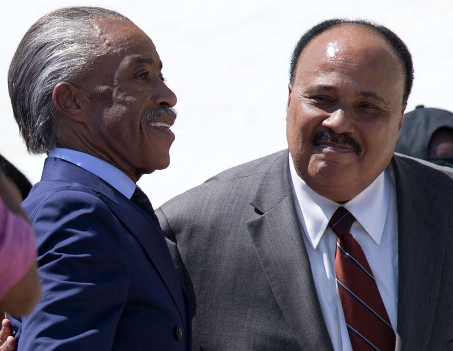 "Rev. Al Sharpton, left, and Martin Luther King III stand together during an event to commemorate the 50th anniversary of the 1963 March on Washington at the Lincoln Memorial, Saturday, Aug. 24, 2013, in Washington. Tens of thousands of people marched to the Martin Luther King Jr. Memorial and down the National Mall on Saturday, to commemorate King's famous """"I Have a Dream"" speech, made Aug. 28, 1963, during the March on Washington, and pledging that his dream includes equality for gays, Latinos, the poor and the disabled. Photo: Carolyn Kaster, Associated Press / AP"