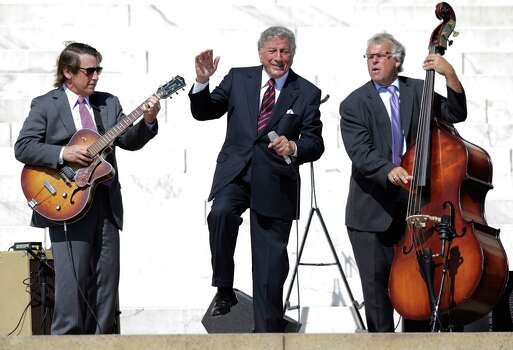"Singer Tony Bennett, center, performs during an event to commemorate the 50th anniversary of the 1963 March on Washington at the Lincoln Memorial, Saturday, Aug. 24, 2013, in Washington. Tens of thousands of people marched to the Martin Luther King Jr. Memorial and down the National Mall on Saturday, to commemorate King's famous """"I Have a Dream"" speech, made Aug. 28, 1963, during the March on Washington, and pledging that his dream includes equality for gays, Latinos, the poor and the disabled. Photo: Carolyn Kaster, Associated Press / AP"