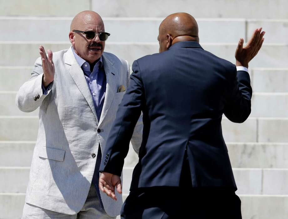 Radio host Tom Joyner, left, greets Rep. John Lewis, D-Ga., as he arrives to speak at a rally to commemorate the 50th anniversary of the 1963 March on Washington on the steps of the Lincoln Memorial on Saturday, Aug. 24, 2013, in Washington. Photo: Carolyn Kaster, Associated Press / AP