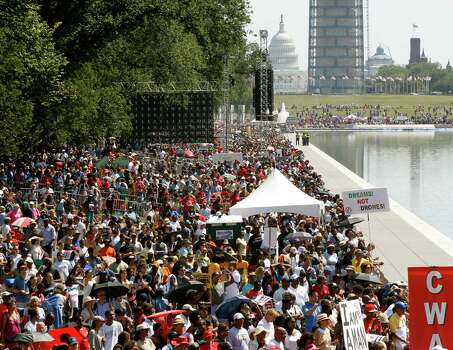 People line the Reflecting Pool between the Washington National Monument, top right, and the Lincoln Memorial as they rally to commemorate the 50th anniversary of the Aug. 28, 1963, March on Washington Saturday, Aug. 24, 2013, in Washington. Photo: Jon Elswick, Associated Press / AP