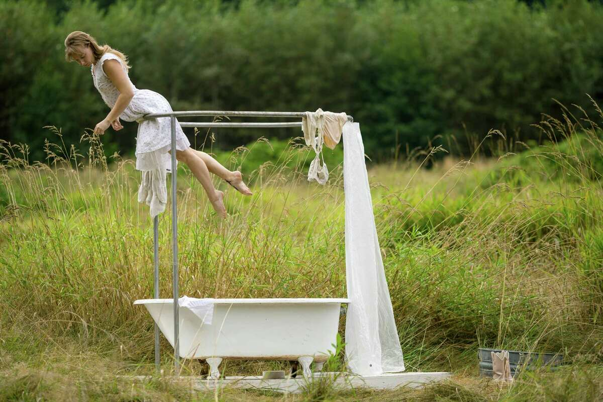 """Elizabeth Rose, of the Acrobatic Conundrum, plays on an installation at the seventh annual Lo-Fi Festival Saturday, August 24, 2013, at The Smoke Farm in Arlington. This year's theme was """"Must Be Present to Win!"""""""