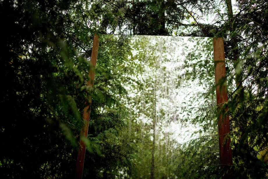 """Mirror installations distort the view of a leafy corner of the property at the seventh annual Lo-Fi Festival Saturday, August 24, 2013, at The Smoke Farm in Arlington. This year's theme was """"Must Be Present to Win!"""" Photo: JORDAN STEAD, SEATTLEPI.COM / SEATTLEPI.COM"""