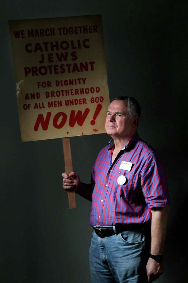 Craig Oettinger, a retired UH Clear Lake sociology professor, kept the protest sign he was given when he arrived to Washington on Wednesday, Aug. 21, 2013, in Houston. Photo: Mayra Beltran, Houston Chronicle / © 2013 Houston Chronicle