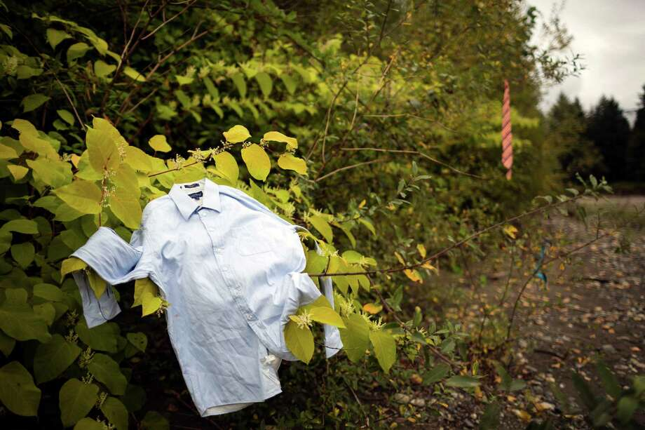 "Clothes are scattered about on the riverbank near the ""Gender Hut"" piece at the seventh annual Lo-Fi Festival Saturday, August 24, 2013, at The Smoke Farm in Arlington. This year's theme was ""Must Be Present to Win!"" Photo: JORDAN STEAD, SEATTLEPI.COM / SEATTLEPI.COM"