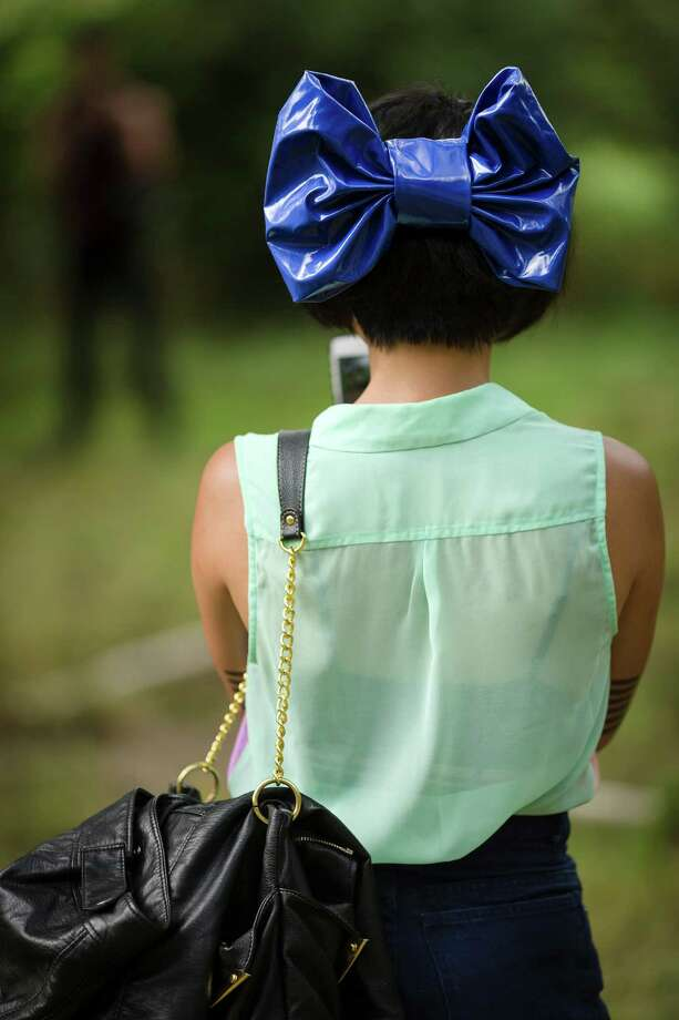 "An attendee wears an over-sized blue bow at the seventh annual Lo-Fi Festival Saturday, August 24, 2013, at The Smoke Farm in Arlington. This year's theme was ""Must Be Present to Win!"" Photo: JORDAN STEAD, SEATTLEPI.COM / SEATTLEPI.COM"