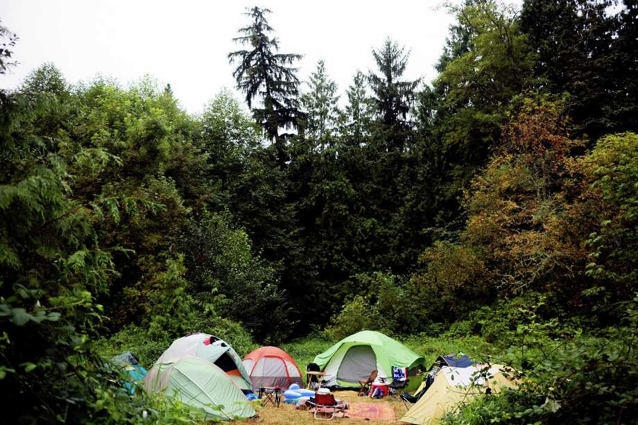 "Tents populate a quiet clearing in the quiet camping area at the seventh annual Lo-Fi Festival Saturday, August 24, 2013, at The Smoke Farm in Arlington. This year's theme was ""Must Be Present to Win!"" Photo: JORDAN STEAD, SEATTLEPI.COM / SEATTLEPI.COM"