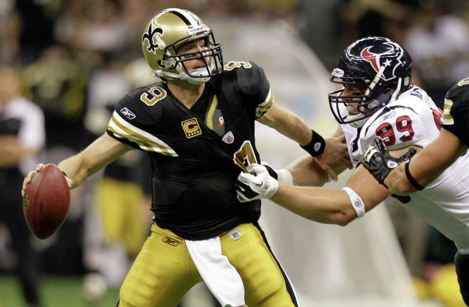 Texans defensive end J.J. Watt, right, enjoys going up against quarterbacks of the quality of the Saints' Drew Brees, but Watt will see little playing time today. Photo: Brett Coomer, HC Staff / © 2011 Houston Chronicle