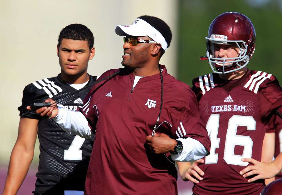 Texas A&M coach Kevin Sumlin, with freshmen Kenny Hill (left) and Shane Tripucka, will have to keep his players from thinking too highly of themselves in a season with huge expectations. Photo: Karen Warren / Houston Chronicle