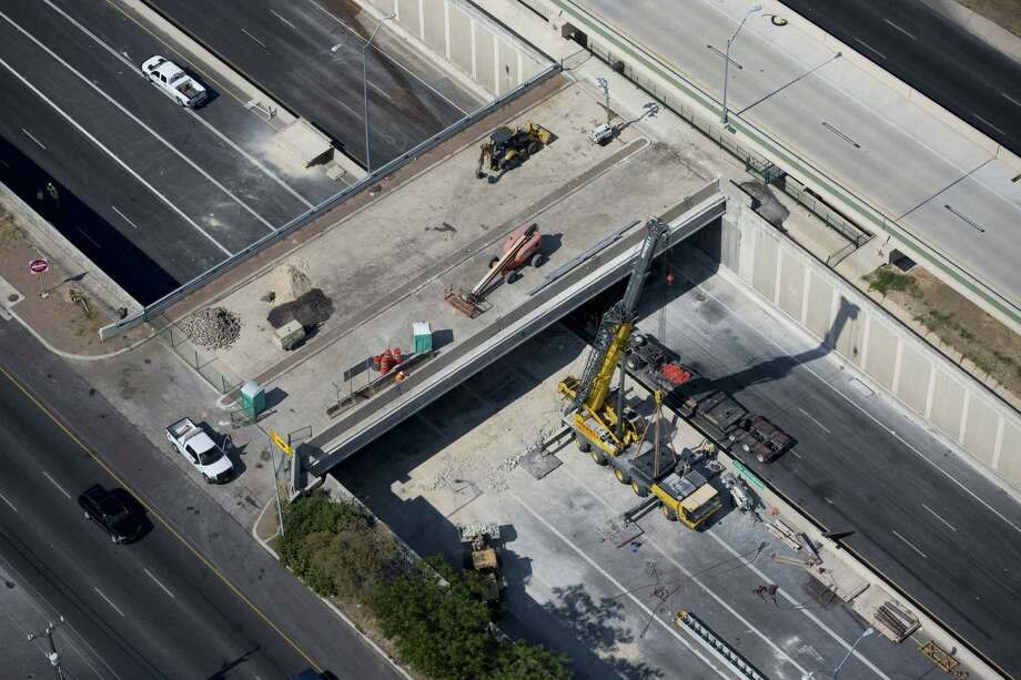 Part of the Henderson Pass bridge was damaged when an 18-wheeler slammed into it Aug. 14. Repairs were completed a day and a half ahead of schedule, and all lanes of U.S. 281 were reopened Saturday. Photo: William Luther / San Antonio Express-News