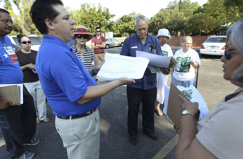 "Weston Martinez, holding recall petition forms, says, ""Bernal and others are using LGBT people as a political football."" Photo: Kin Man Hui / San Antonio Express-News"