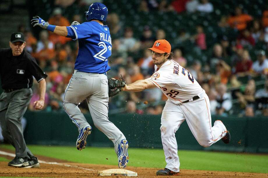 The Blue Jays' Kevin Pillar is too quick down the first-base line for the Astros' Brett Wallace to catch, reaching safely on a bunt single during the ninth inning of Saturday night's game at Minute Maid Park. Photo: Smiley N. Pool / © 2013  Smiley N. Pool