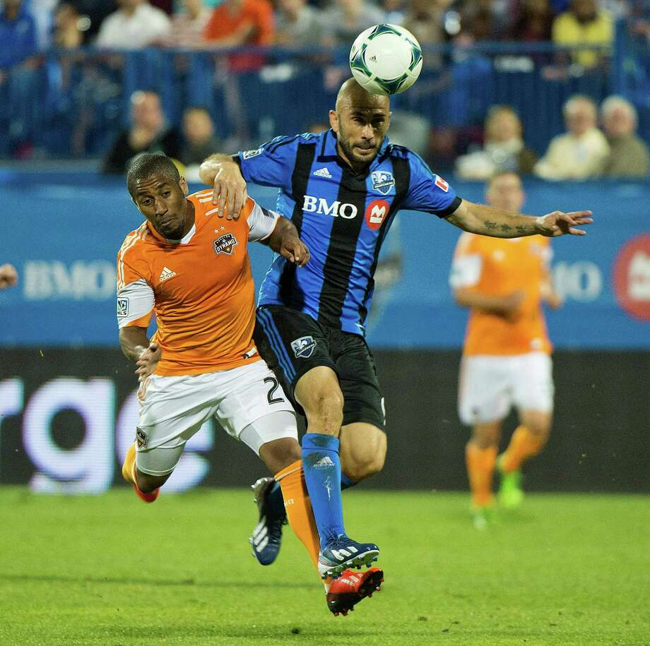 The Impact's Marco Di Vaio, right, was a step ahead of the Dynamo and defender Corey Ashe all match. Photo: Graham Hughes, SUB / The Canadian Press